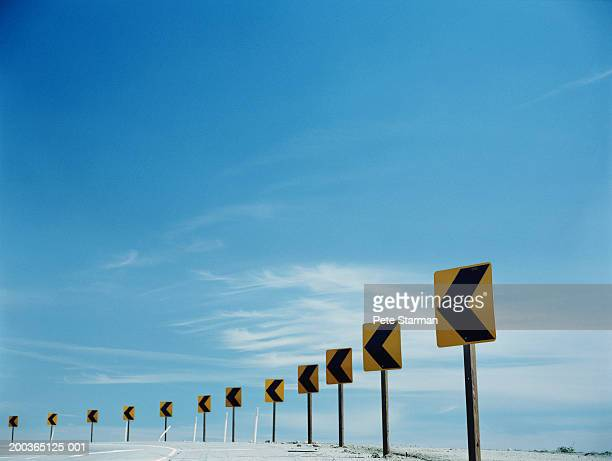 traffic arrows around bend in round - curved arrows stock-fotos und bilder