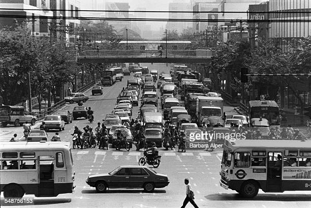 Traffic at an intersection on a main road in Bangkok Thailand 25th February 1988