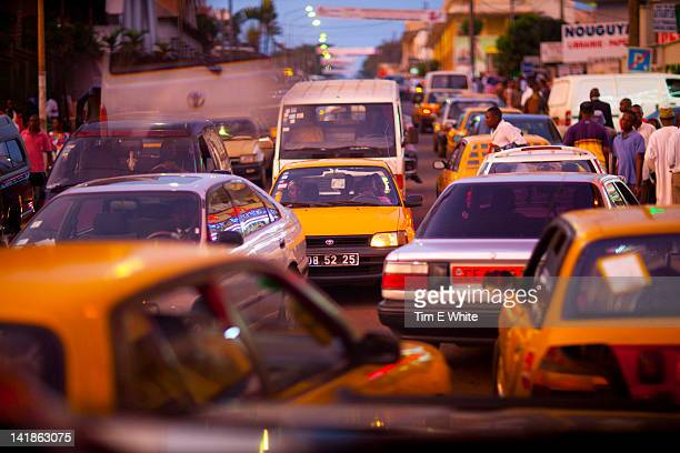 traffic at dusk, yaounde cameroon - cameroon stock pictures, royalty-free photos & images