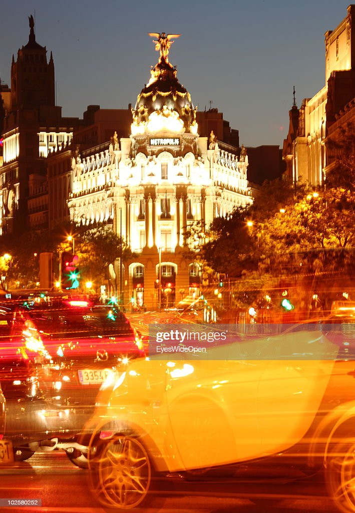 Traffic at night drive past the Metropolis building at the famous boulevard Gran Via in Madrid on May 20, 2010 in Madrid, Spain. Madrid is a big european city with more than 3 million inhabitants.