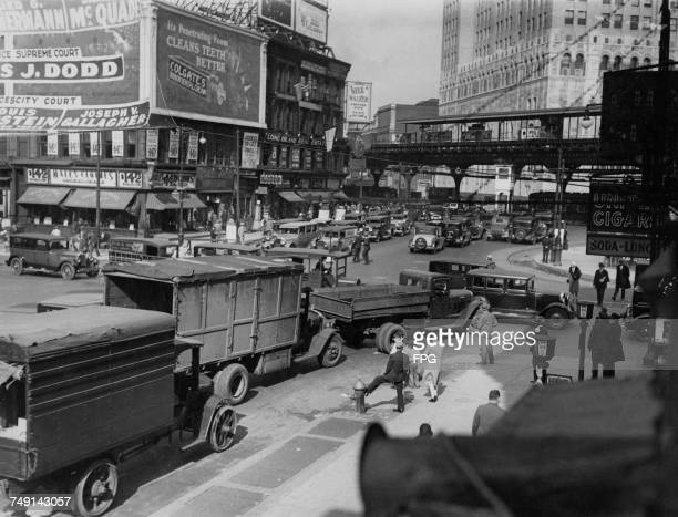 Traffic at the corner of Flatbush Avenue and Atlantic Avenue in Brooklyn, New York City, 1929. At top right is an election poster for Supreme Court...