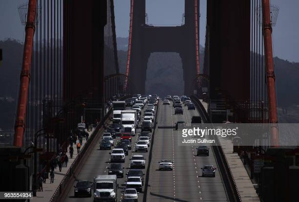 Traffic backs as it travels northbound on the Golden Gate Bridge on May 1 2018 in Sausalito California California and 17 other states filed a lawsuit...