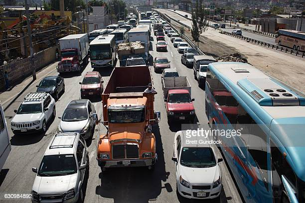 Traffic backs up as people block a highway leaving Mexico City as a protest to an increase in gas prices on January 4 2017 in Mexico City Mexico On...
