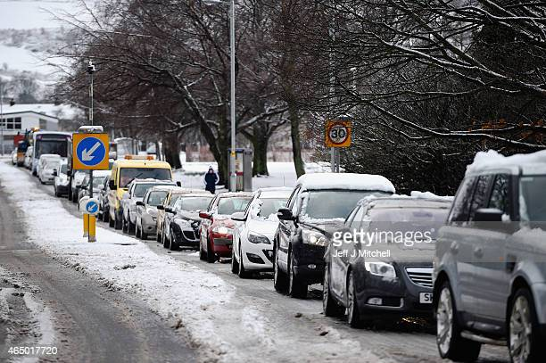 Traffic backs up as snow fall closes a number of schools and affected driving conditions on March 3 2015 in BallochScotland The Met Office has a...