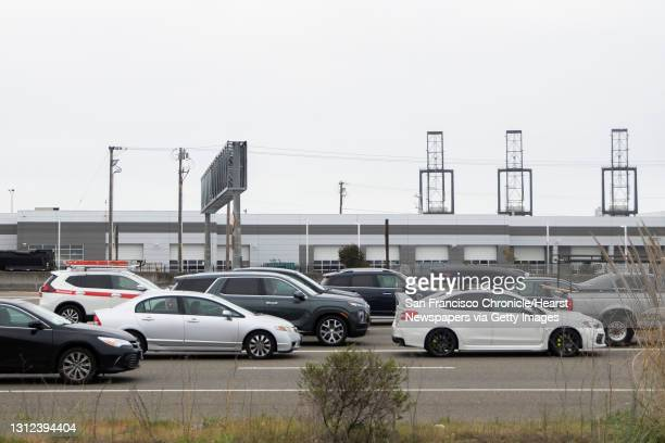Traffic backs up at the toll plaza along Interstate 80 westbound in Emeryville, Calif. Tuesday, April 6, 2021 as morning commuters make their way...
