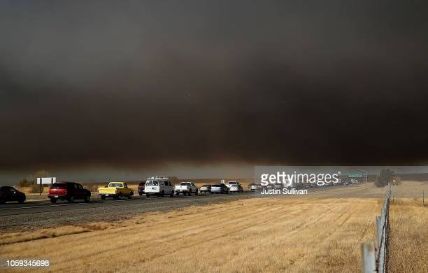 Traffic backs up on highway 70 as people evacuate from the Camp Fire as it moves through the area on November 8 2018 in Paradise California Fueled by...