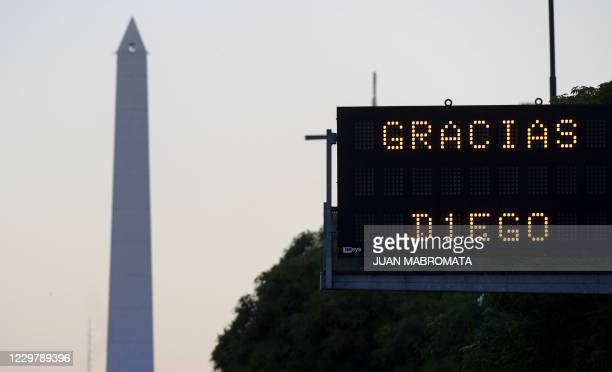 """Traffic board reading """"Thanks Diego"""" pays homage to Argentinian football legend Diego Maradona on the day of his death in Buenos Aires, on November..."""