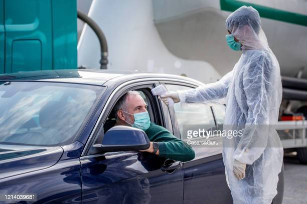 traffic body fever temperature control - infrared thermometer stock pictures, royalty-free photos & images
