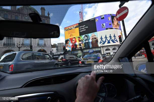 Traffic builds up in Picadilly Circus in central London on May 12 during the novel coronavirus COVID-19 pandemic. - The British government on Monday...