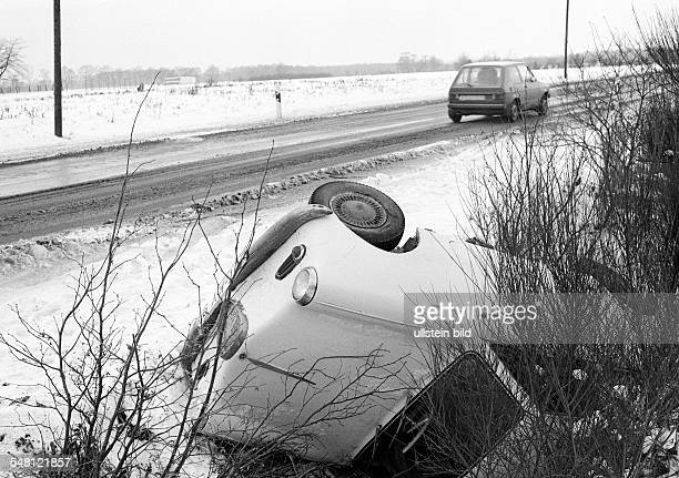 traffic car accident on a country road passenger car lies in the roadside ditch DBottrop DBottropKirchhellen Ruhrgebiet North RhineWestphalia