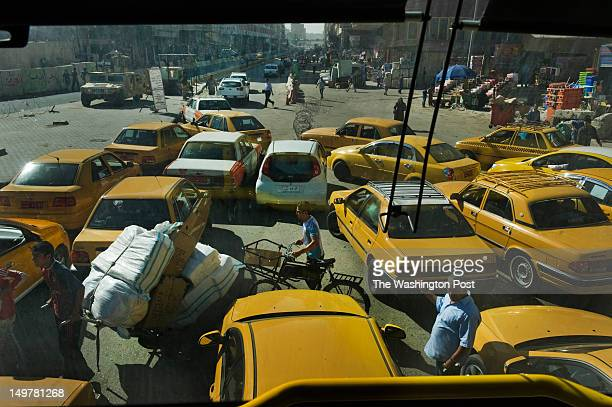 Traffic chaotically bottlenecks at a security checkpoint in central Baghdad where vehicles are funneled into a single lane for security forces to...