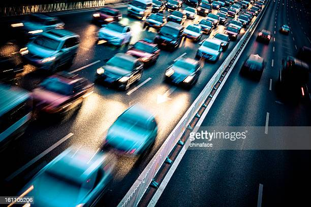 traffic city night - vehicle light stock photos and pictures