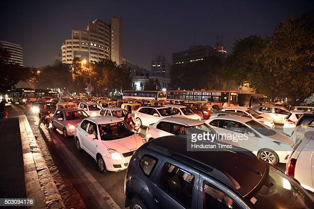 Traffic clogged the roads at Connaught Place on the first day of Delhi's OddEven Vehicle Plan on January 1 2016 in New Delhi India The oddeven scheme...
