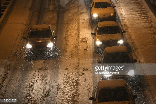 Traffic comes to a standstill on the A50 trunk road through Stoke-On-Trent as vehicles struggle in heavy snow and people abandon their cars causing...