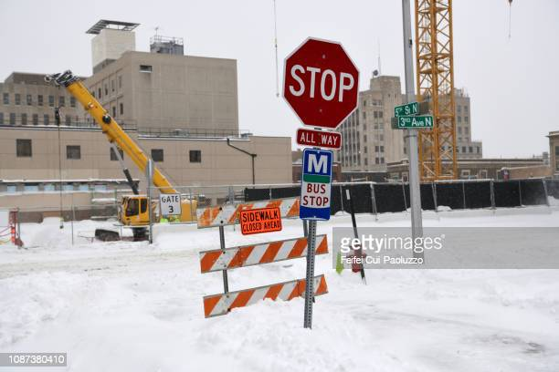 traffic cone and stop sign at fargo, north dakota, usa - fargo north dakota stock pictures, royalty-free photos & images