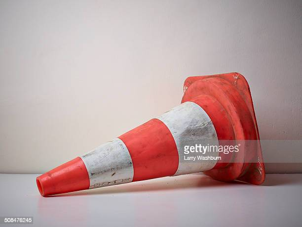 traffic cone fallen on floor - traffic cone stock pictures, royalty-free photos & images
