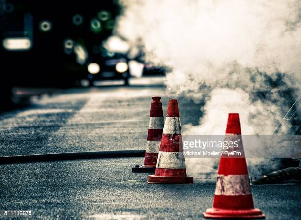 traffic cone on street - traffic cone stock pictures, royalty-free photos & images