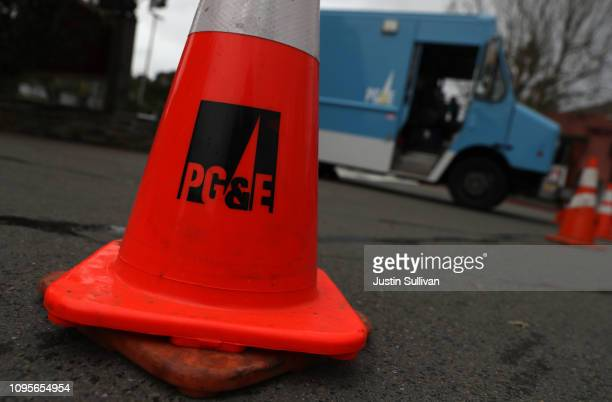 Traffic cone sits next to a Pacific Gas & Electric truck on January 17, 2019 in Fairfax, California. PG&E announced that they are preparing to file...
