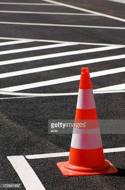 Traffic cone sitting on the street