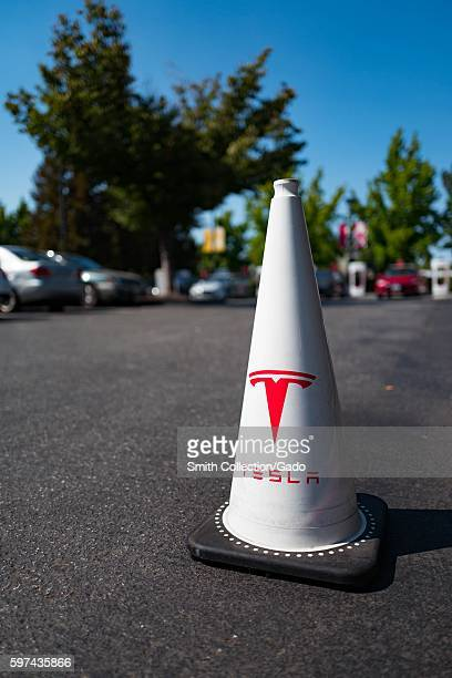 Traffic cone with logo for the electric vehicle company Tesla Motors in a parking lot in the Silicon Valley town of Mountain View California August...