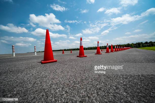 traffic cone,an image of cautions on asphalt road - crash site stock pictures, royalty-free photos & images
