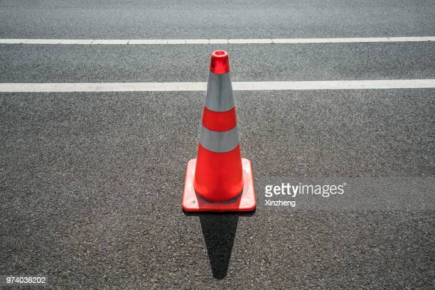 traffic cone,an image of cautions on asphalt road - traffic cone stock pictures, royalty-free photos & images