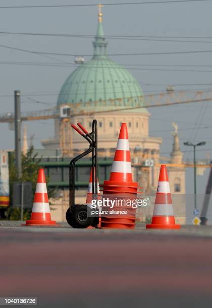 Traffic cones are set out in front of the backdrop of St.Nicholas' Church in Potsdam, Germany, 02 October 2014. A 250 kg American aerial bomb from...