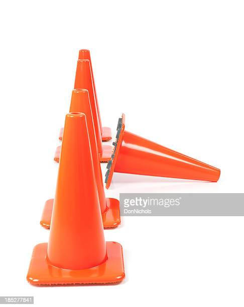 traffic cones in a row, one standing out - cone shaped objects stock pictures, royalty-free photos & images
