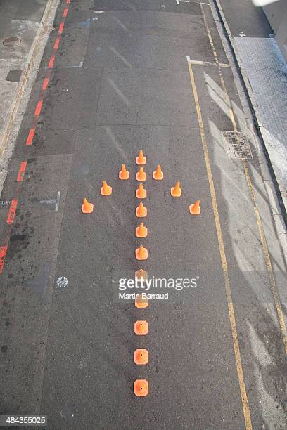 Traffic cones in arrow-shape