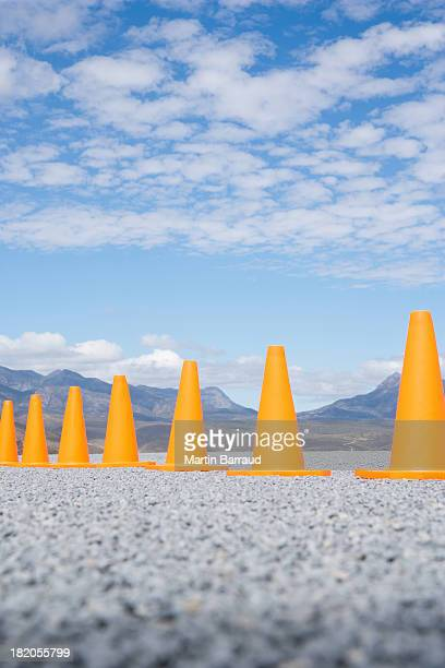traffic cones in line outdoors ground level view - rules stock pictures, royalty-free photos & images