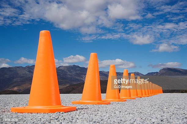 traffic cones in line outdoors ground level view - traffic cone stock pictures, royalty-free photos & images