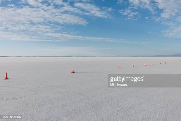 traffic cones marking race course on salt flats at dusk - bonneville salt flats stock pictures, royalty-free photos & images