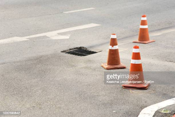 traffic cones on city street - traffic cone stock pictures, royalty-free photos & images