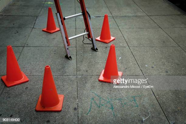 traffic cones on footpath - alessandro miccoli stockfoto's en -beelden