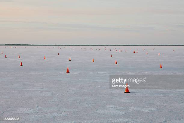 Traffic cones on race course, Bonneville Salt Flats, Speed Week, dusk