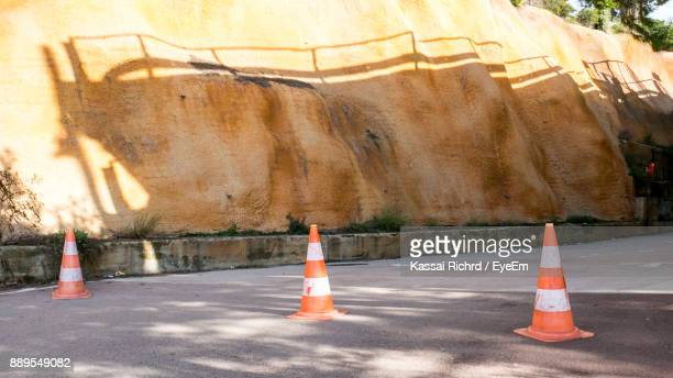 Traffic Cones On Road By Retaining Wall