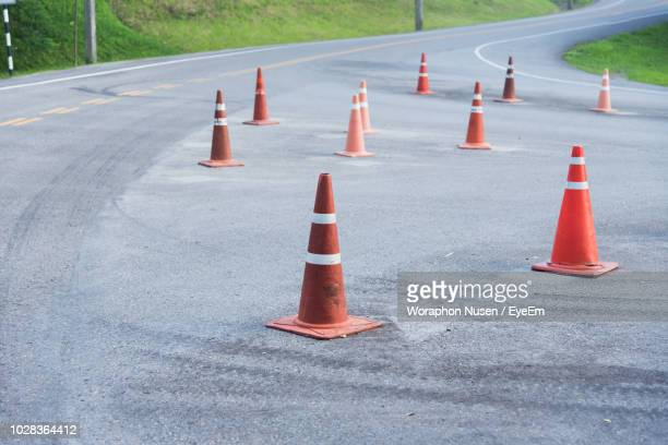 traffic cones on road in city - cone shape stock pictures, royalty-free photos & images