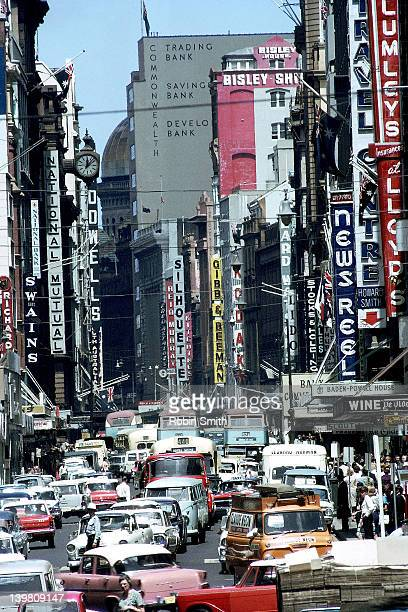 Traffic congestion & advertising signs in George Street, Sydney, 1964