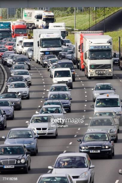 Traffic congestion cars and trucks in all carriageways on M25 motorway London United Kingdom