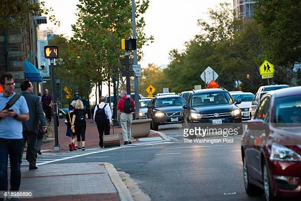 Traffic congestion is pictured in Bethesda Maryland during rush hour traffic on Tuesday October 18 2016 Pedestrians cross Old Georgetown Rd at...