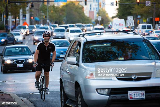 Traffic congestion is pictured in Bethesda Maryland during rush hour traffic on Tuesday October 18 2016 Traffic and a bicycle commuter is pictured on...