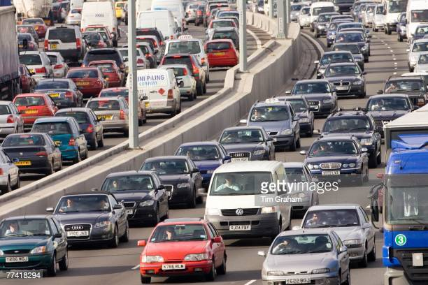 Traffic congestion of cars and vans in both directions on M25 motorway near London United Kingdom