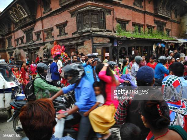 traffic control by single police officer in large group of nepalese people at Thamel Kathmandu
