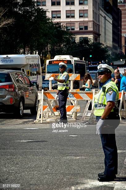 NYPD Traffic Control Officers Directing Vehicular Traffic, Midtown Manhattan, NYC
