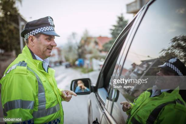 traffic control on the road - traffic police officer stock pictures, royalty-free photos & images