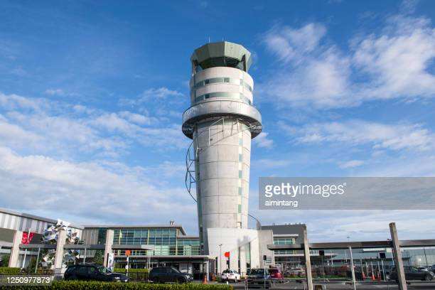 traffic control tower at christchurch airport - christchurch stock pictures, royalty-free photos & images
