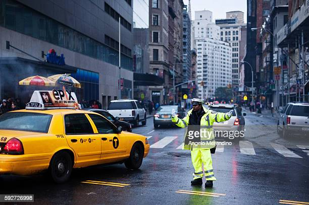 A traffic cop directs traffic outside of Union Square where traffic lights are not working due to power outages caused by Hurricane Sandy