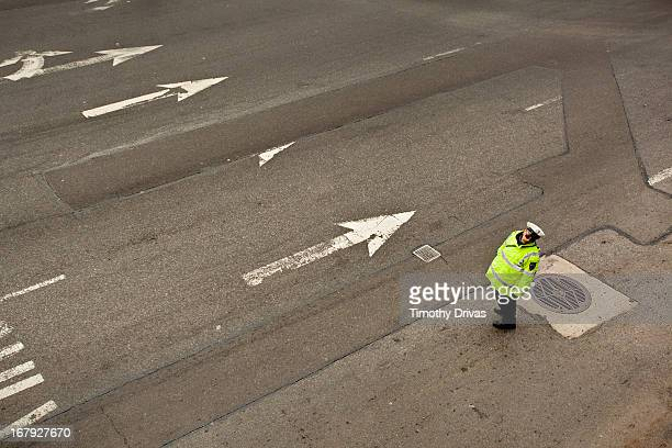 NYPD traffic cop stands at the Intersection of 2nd Avenue and 60th Street in Manhattan
