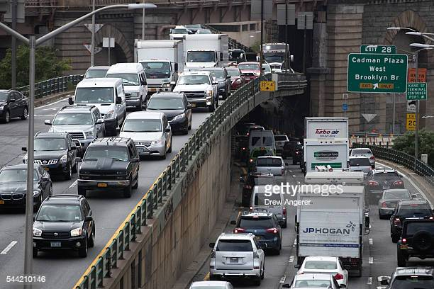 Traffic crawls on the BrooklynQueens Expressway July 1 2016 in the Brooklyn borough of New York City Officials from the American Automobile...