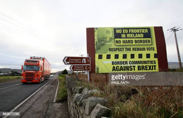 Traffic crosses the border into Northern Ireland from the Irish Republic alongside a Brexit Border poster on the Dublin road Co Armagh border between...